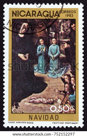 "NICARAGUA - CIRCA 1983: A stamp printed in Nicaragua from the ""Christmas"" issue shows Adoration of the Shepherds (Hugo van der Goes), circa 1983."