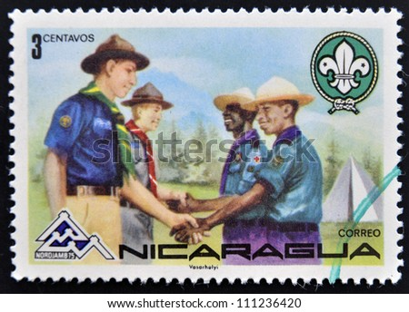 NICARAGUA - CIRCA 1975: A stamp printed in Nicaragua shows meeting between boy scout groups, circa 1975