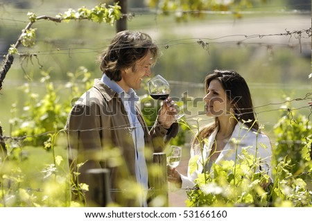 Nice adult couple in a vineyard