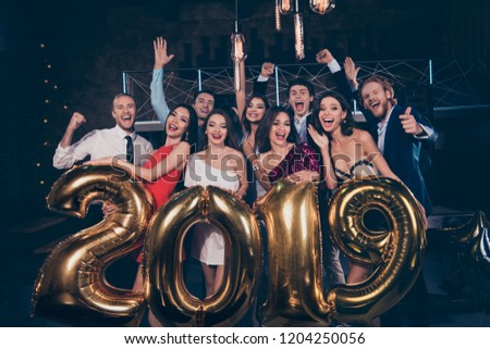Nice amazing beautiful attractive pretty charming cheerful glad ladies and handsome gentlemen, chill out at fashionable night club, raising hands up, waving, holding shiny bright 2019 symbol figure