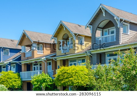 Nice and comfortable neighborhood, community. Some homes, town houses with nicely landscaped yard in the suburbs of the North America. Canada.