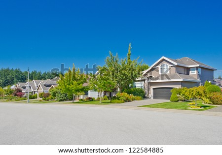 Nice and comfortable neighborhood. Some homes in the suburbs of the North America. Canada.