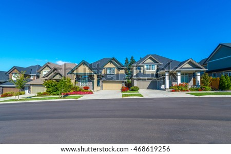 Shutterstock Nice and comfortable neighborhood. Some homes on the empty street in the suburbs of the North America. Canada.