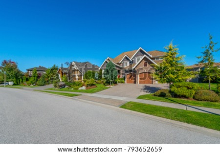 Nice and comfortable neighborhood. Some homes on the empty street in the suburbs of Vancouver, Canada. #793652659