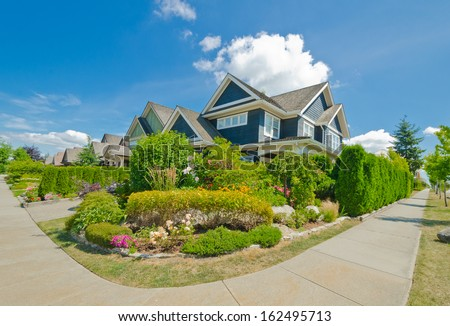 Nice and comfortable neighborhood. Some homes with nicely landscaped front yards in the suburbs of Vancouver, Canada.