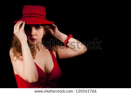 Nice and elegant young woman with a red hat.