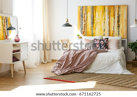 Nice and stylish bedroom in warm colors #671162725