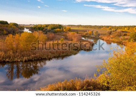 Nice autumn scene on river in evening time