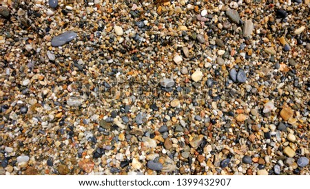 Nice background image of pebbles on the beach.  Pebbles close up.  Wet pebbles closeup.  The pebbles on the beach are wet. #1399432907
