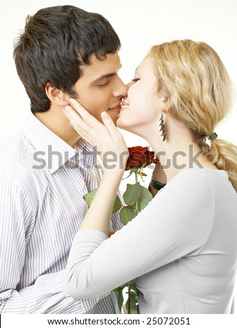 Nice beautiful couple in love with rose - stock photo