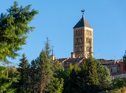 Nice bell tower of the church of San Esteban in Segovia illuminated by the light of the sunset in autumn