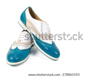 Nice blue and white woman shoes with laces on isolated white background #278865593
