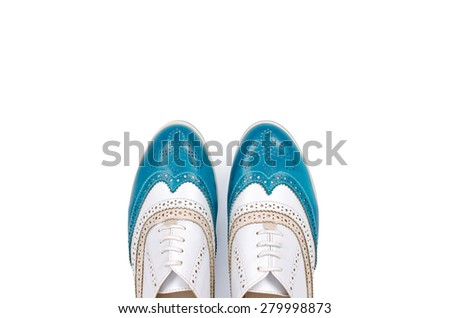 Nice blue and white woman shoes with laces on isolated white background #279998873
