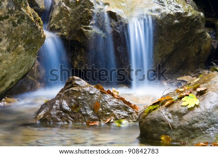 nice blue water of stream in autumn forest