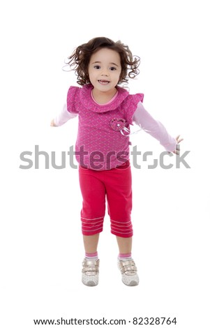 Nice brazilian child girl jumping, isolated on white.