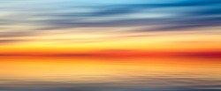 Nice bright red yellow blue abstract blur texture background web banner panorama landscape with sunset on lake
