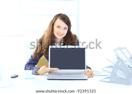 Nice business woman in the office, representation of the laptop.
