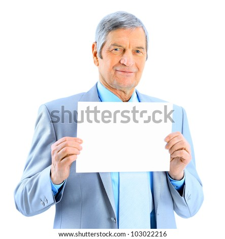 Nice businessman at the age of't holding a big white poster. Isolated on a white background.