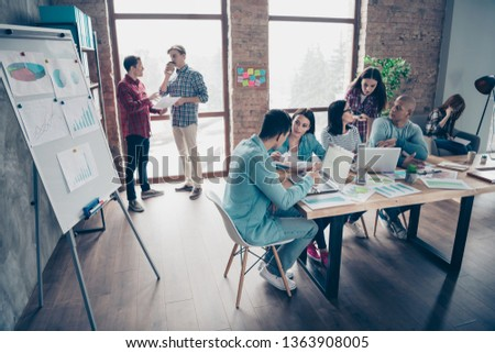 Nice busy attractive serious professional experienced specialists experts managers wearing casual making growth development analysis at industrial loft interior workplace workstation