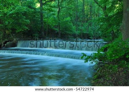 nice cascade in green forest