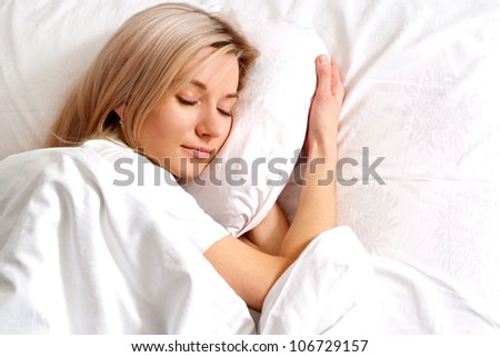 Nice Caucasian woman sleeping on the bed