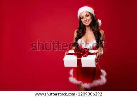 Nice charming pretty adorable positive cheerful glad curly-haired lady in hat and fluffy dress, getting, holding gift box, isolated over bright vivid red background