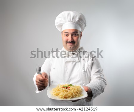 nice chef with pasta dish