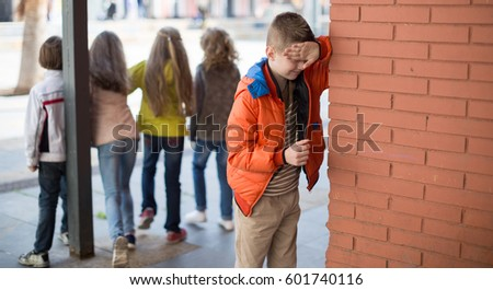 nice Children playing hide and seek in the schoolyard