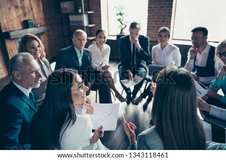 Nice classy stylish trendy cheerful sharks experts ceo boss chief sitting on chairs in circle discussing financial plan development at modern industrial loft interior work place space indoors