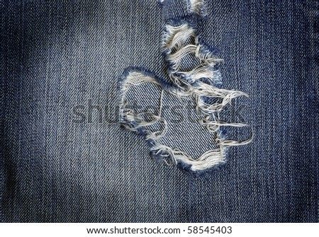 nice closeup blue jeans texture with big hole