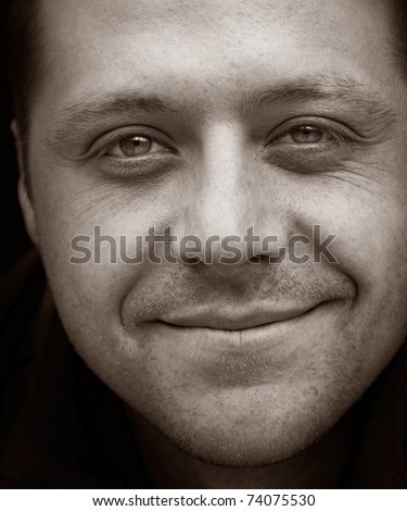 Nice closeup  portrait of young smilling man