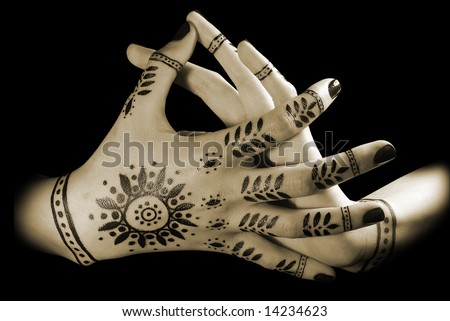 stock photo : Nice closeup women's hands with oriental tattoo isolated over