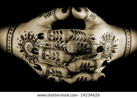 http://image.shutterstock.com/display_pic_with_logo/212440/212440,1214556882,10/stock-photo-nice-closeup-women-s-hands-with-oriental-tattoo-isolated-over-black-14234626.jpg