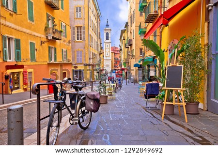 Nice colorful street architecture and church view, tourist destination of French riviera, Alpes Maritimes depatment of France #1292849692