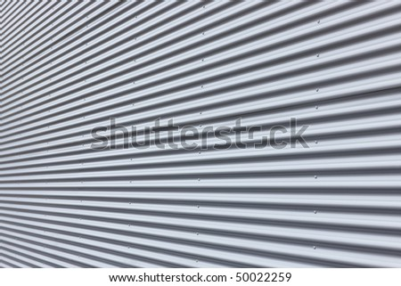 Nice corrugated aluminium wall with diminishing perspective.