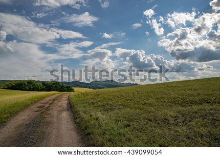 nice countryside with agricultural road on the left side