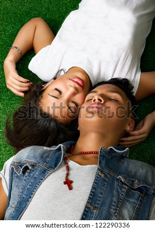 nice couple relaxing on green grass