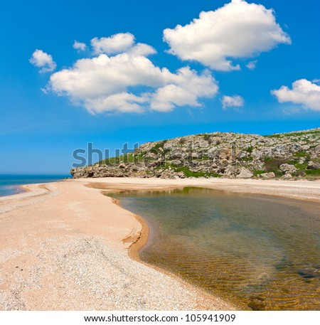 Nice day on sea beach with white clouds in blue sky