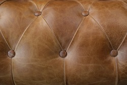 Nice detail of vintage style sofa in brown leather