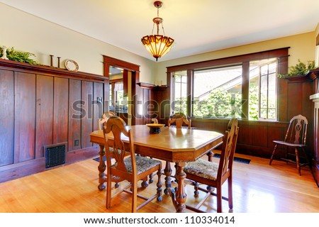 Nice dining room with wood walls and hardwood floor in an old house.