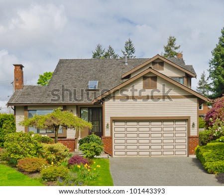 Nice double garage house in the residential neighborhood. Canada.