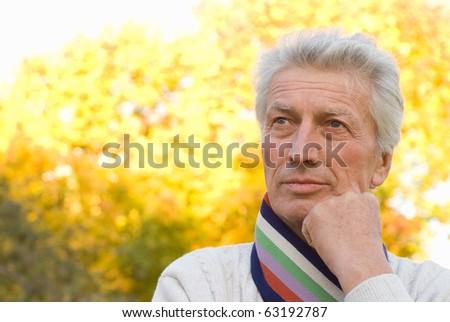 nice elderly man in a autumn park