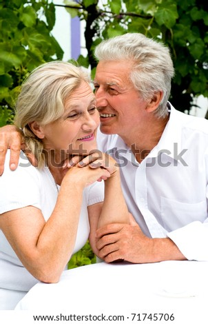 nice elderly together in a summer park