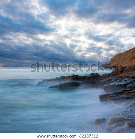 Nice evening scene on sea shore - stock photo