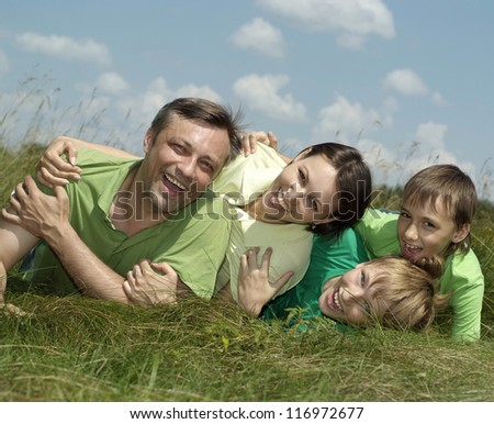 nice family in the green jersey in a summer park
