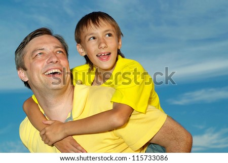 Nice family outdoors on blue sky background