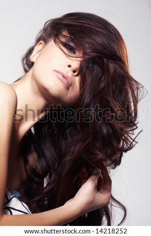 Nice fashion girl posing on light background