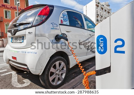 NICE, FRANCE - AUGUST 23, 2014: Electric car at Auto Bleue charging station - popular urban self service car sharing service in Nice with more than sixty stations and over 200 electric vehicles.