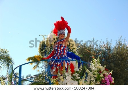 NICE, FRANCE - FEBRUARY 22: Carnival of Nice, Flowers' battle. This is the main winter event of the Riviera. The artist dressed in the costume of French flag colors. Nice, France - Feb 22, 2012
