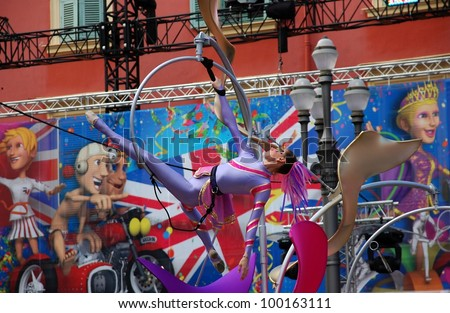 NICE, FRANCE - FEBRUARY 21: Carnival of Nice in French Riviera. This is the main winter event of the Riviera. 2012 theme is the King of Sport. Young woman gymnast Nice, France - Feb 21, 2012